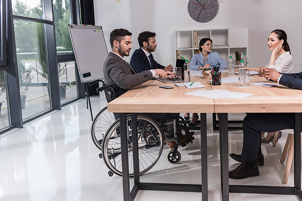Group of diverse people in a meeting at an accessible table